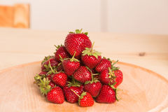 Fresh, juicy strawberries on a wood table Royalty Free Stock Photography