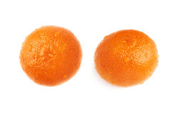 Fresh juicy tangerines fruits covered with the multiple water drops, isolated over the white background Royalty Free Stock Images