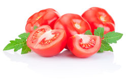 Fresh Juicy tomato with green leaves Isolated on white Stock Photo