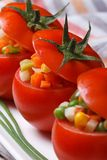 Fresh juicy tomatoes filled with a salad of vegetables Stock Image