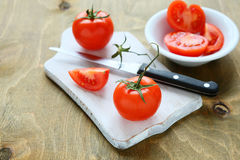 Fresh juicy tomatoes on a white board Royalty Free Stock Photos