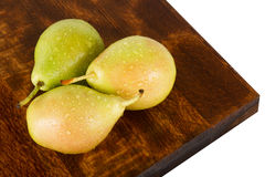 Fresh juicy water-sprinkled pears on white background Royalty Free Stock Photography