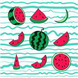 Fresh and juicy whole watermelons and slices on striped blue background. Fresh and juicy whole watermelons and slices on striped blue and white background Royalty Free Stock Photography