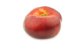 Fresh and juicy wild flat nectarine Royalty Free Stock Image