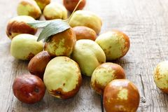 Fresh jujube on wooden table. Unabi fruit royalty free stock images