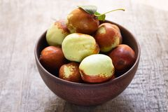 Fresh jujube on wooden table. Unabi fruit royalty free stock photo
