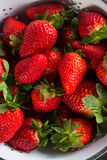 Fresh just clean wet strawberries in rustic colander Royalty Free Stock Photography