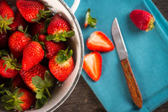 Fresh just clean wet strawberries in rustic colander Stock Photos