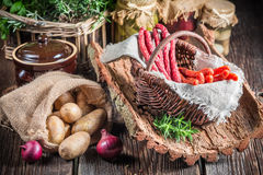 Fresh kabanos sausages in basket Royalty Free Stock Image