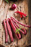 Fresh kabanos sausages in pantry Royalty Free Stock Photography