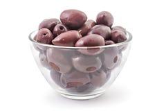 Fresh kalamata olives. Bunch of fresh raw purple black kalamata olives in the glass bowl, isolated on white background Stock Photography