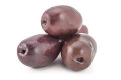 Fresh kalamata olives. Pile of fresh raw purple black kalamata olives, isolated on white background Stock Images