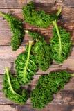 Fresh kale. On wood background royalty free stock image