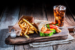 Fresh kebab with cod drink and fries Stock Photography