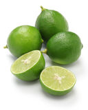 Fresh key limes. On white background Royalty Free Stock Photos