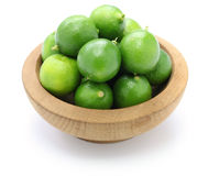 Fresh key limes. In wooden bowl Stock Photos