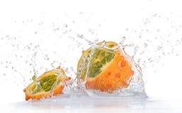Fresh kiwana fruit with water splash Royalty Free Stock Photography