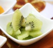 Fresh kiwi. Some fresh slices of a kiwi in a bowl stock photo