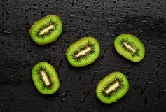 Fresh kiwi on black background. Copy-Space Royalty Free Stock Image