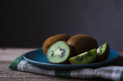 Fresh kiwi on a blue plate Royalty Free Stock Photography