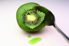 A fresh kiwi destroyed by spoon Stock Image