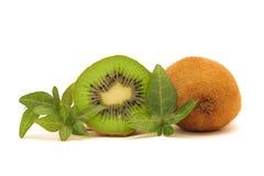 Fresh kiwi fruit. Kiwi fruits with green leaves isolated on white Stock Image