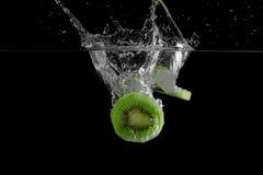 Fresh Kiwi Fruit. Falling into water stock photo