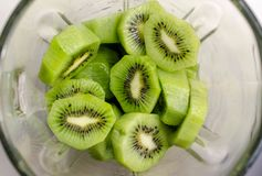 Fresh Kiwi Fruit in a blender. Fresh kiwi macro shot detailed shot, can be used as background Royalty Free Stock Photography