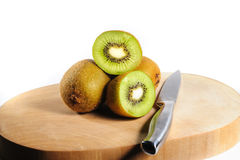 Fresh Kiwi Fruit on Chopping Board with a knife Stock Image