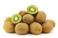 Fresh kiwi fruit and a cut one Royalty Free Stock Images
