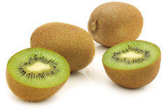 Fresh kiwi fruit and a cut one Stock Images