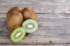 Fresh kiwi fruit on old  wood background Royalty Free Stock Photos