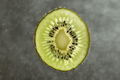 Fresh kiwi fruit slice on blurred background Stock Photos