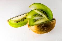 Fresh kiwi fruit slices background stock photos