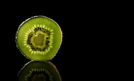 Fresh kiwi fruit splashing in the water isolated. With bubbles royalty free stock photography