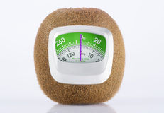 Fresh Kiwi Fruit and weight measurement meter-diet concept Stock Images