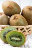 Fresh kiwi fruit whole and cut Royalty Free Stock Photography