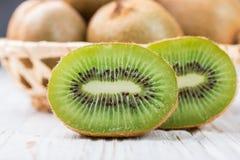 Fresh kiwi fruit whole and cut Royalty Free Stock Images