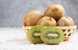 Fresh kiwi fruit whole and cut Stock Photos