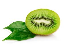 Fresh kiwi fruits with green leaves Royalty Free Stock Images
