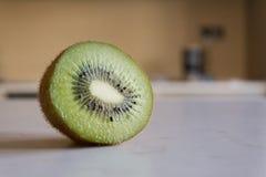 Fresh kiwi on a kitchen`s table Royalty Free Stock Photo