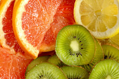 Fresh kiwi, lemon and grapefruit background Stock Photo
