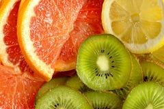 Fresh kiwi, lemon and grapefruit background Stock Photo
