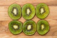 Fresh kiwi slices on cutting board Stock Photo