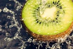 Fresh kiwi splash. Nice ripe kiwi with water splash and droplets Stock Photography