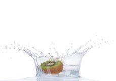 Fresh kiwi in water splash on white backround Stock Image