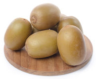 Fresh kiwi on wooden board Stock Photography