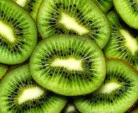 Fresh kiwifruit background. round slices Stock Images