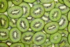 Fresh kiwifruit slices close-up on the table Royalty Free Stock Image
