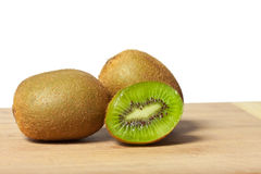 Fresh kiwis on a cutting board Royalty Free Stock Images